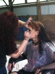 Laura touches up AmArA before the shoot inside.
